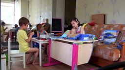 children play and draw in the playroom Footage