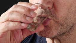 4K Old Man Taking A Drink Of Medical Drops Footage