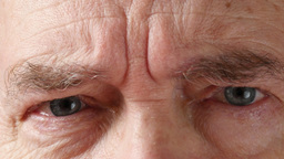 4K Old Man Opens And Closes His Eyes In Front Of The Camera Footage
