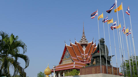 The Thai and Dharmacakra flags with a statue Footage