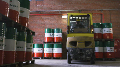 Forklift Loads Tanks Filled with Chemical Reagents Footage