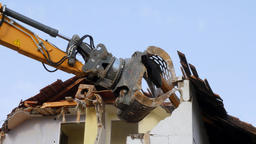Excavator demolishing a house Footage