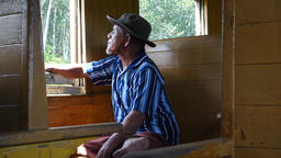 Traveler in old train passenger carriage with wooden bench seat Footage