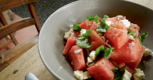 Close up of a healthy watermelon salad with mint and feta cheese in a bowl on a Live Action