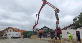 Prefabricated house, Construction Worker concreting a basement ceiling Footage