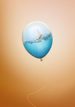 Water inside balloon with sailing small boat creative concept フォト