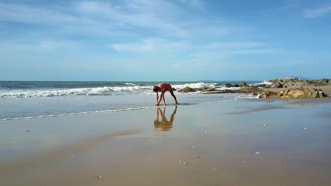 Girl Does Bodily Exercise on Seashore under Sun Shine Live Action