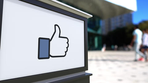 Street signage board with Facebook like button thumb up Live Action