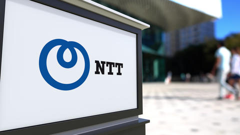 Street signage board with Nippon Telegraph and Telephone Corporation NTT logo Footage