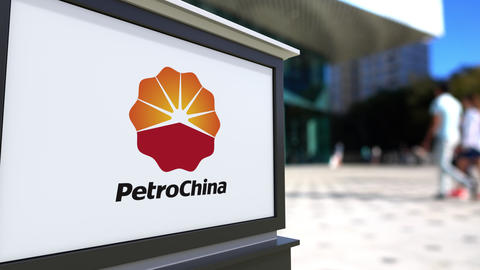 Street signage board with PetroChina logo. Blurred office center and walking Footage