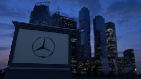 Street signage board with Mercedes-Benz logo in the evening. Blurred business Live Action