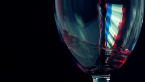 Red wine being pored into wineglass with French flag-like highlight. Winemaking Footage