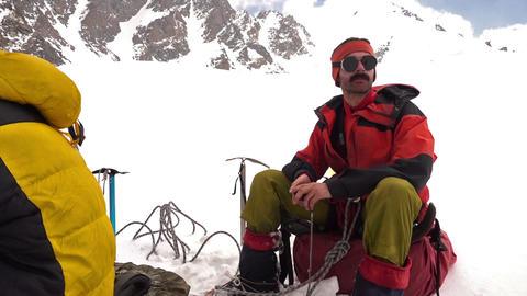 Climber Resting On A Glacier 영상물