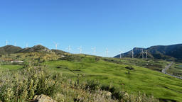 Wind turbines energy renewable moving at the mountains a sunny day Footage