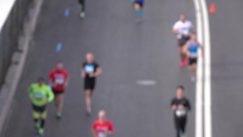 Blurred city marathon runners. Competition concept. Slow motion background bokeh Footage