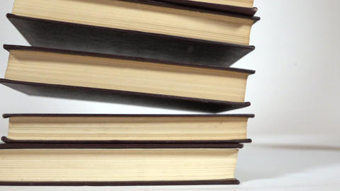 Super slow motion video of falling books Footage