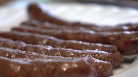 Frying sausages with food burner. 4K close up video Footage