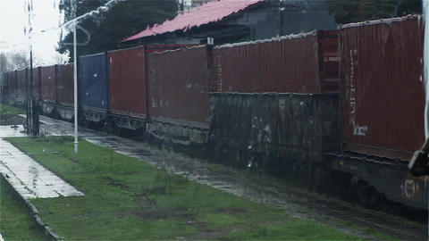 View Of Cargo Train in Terminal From the Cabin Of other Train. Rainy Day Live Action