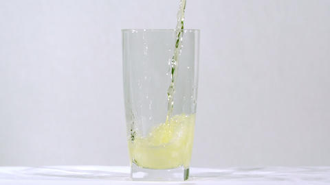 Yellow soda glass pour Footage