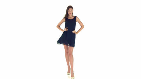Beautiful and sexy young woman in a blue dress with dark hair Footage