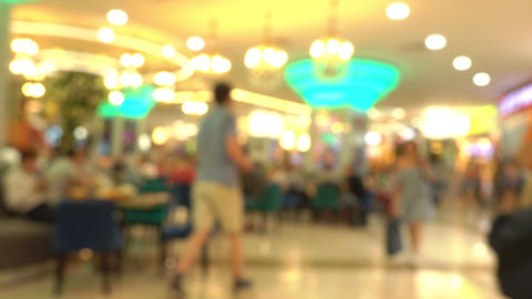 People eating fast food in mall food court. 4K bokeh shot Live Action