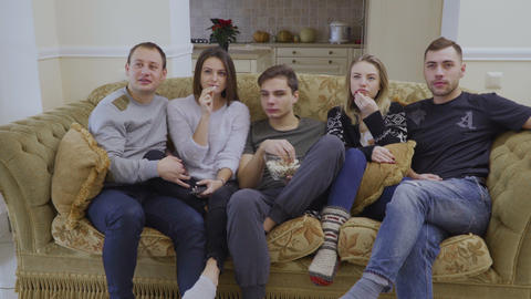 Young friends watches movie at home Footage