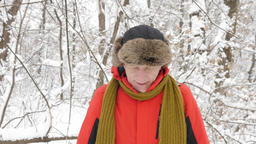 Elderly Caucasian man walks through the winter forest, trying to catch a signal Footage