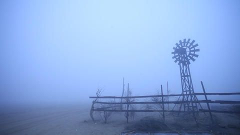 windmill at desert in mist Footage