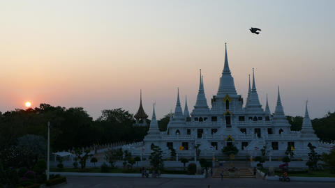 Sunset Time lapse at the Buddhist stupa with multiple spires at Wat Asokaram Footage