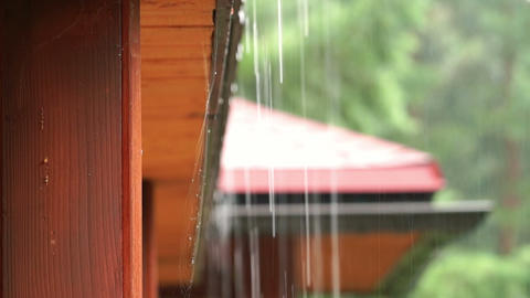 Look at the rain drops from the roof of the cottage Footage