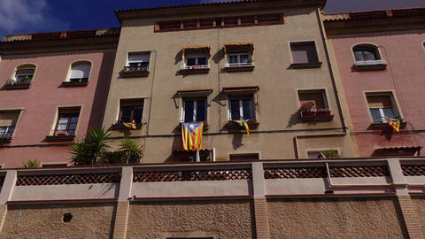 Modern Barcelona house facade, low angle panning shot. Estelada flag hang down Footage