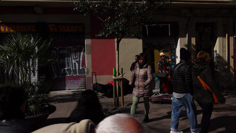 Street musician jazz trio play music and sing at Spanish square, POV camera Footage