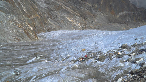 Mountaineers walk through the glacier in the Himalayas Footage