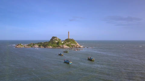 Fishing Boats by Island with Lighthouse under Blue Sky Footage