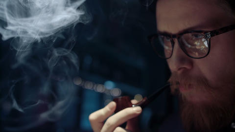 Portrait of man smoking pipe Image