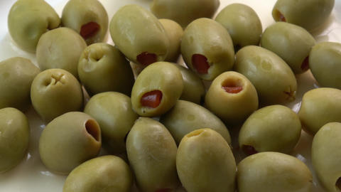Appetizing green olives stuffed with red pepper Footage