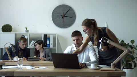 Businesswoman giving assignments to employee Live Action