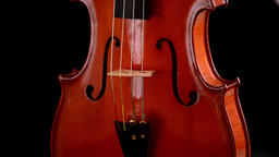 Violin or viola instrument turning at black background Footage