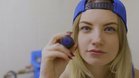 Beautiful girl with screwdriver looks in camera Footage
