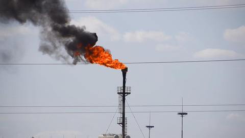 The smoking gas torch. Environmental pollution. Torch system on an oil field Footage