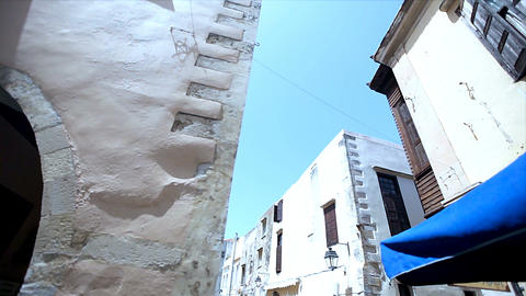narrow street with old houses, maritime touristic town sunny day Footage