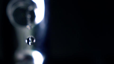 Dripping faucet. Shallow focus. Super slow motion extreme close up shot Footage