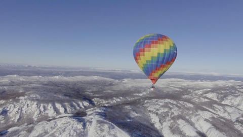 Flight of a colorful balloon over the winter landscape. (Eastern Siberia) Footage