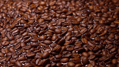 Pouring water on roasted coffee beans, super slow motion shot Footage