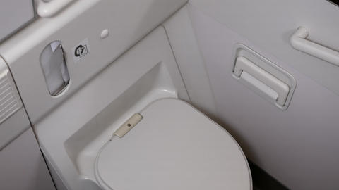 Close up on clean toilet in airplane lavatory with 4k resolution Footage