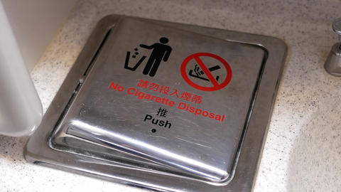 Motion of garbage can with no smoking sign in airplane lavatory with 4k Footage