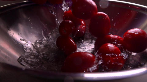 Pouring wet red tomatoes into a pan. Super slow motion video Footage