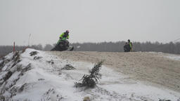 Snowmobile races in the winter season. Championship on snowmobiles January 27 Footage
