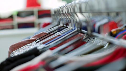 Shooting clothes woman hangers constantly in store indoors. Close up Shot Footage