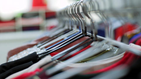 Shooting clothes woman hangers constantly in store... Stock Video Footage